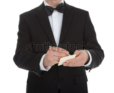 Midsection Of Waiter Writing On Notepad Stock photo © AndreyPopov