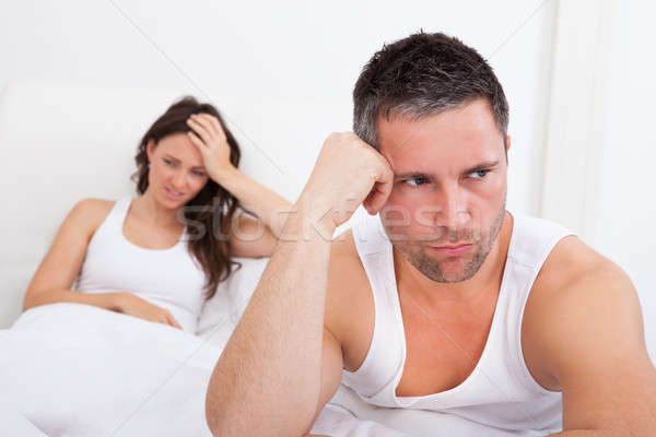 Frustrated Couple On Bed Stock photo © AndreyPopov