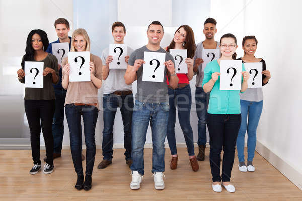 College Students Holding Question Mark Signs Stock photo © AndreyPopov