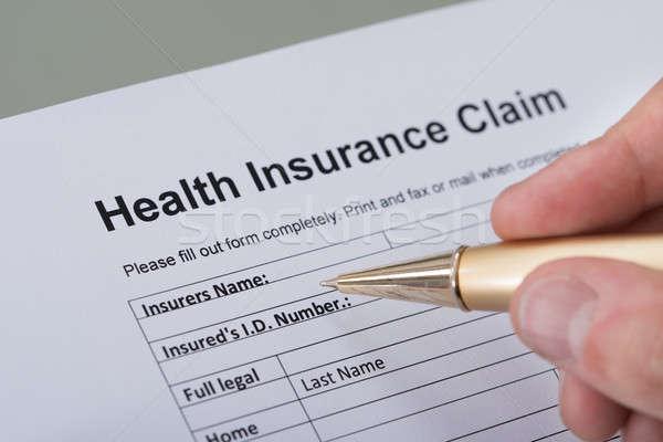Hand Filling Health Insurance Form Stock photo © AndreyPopov