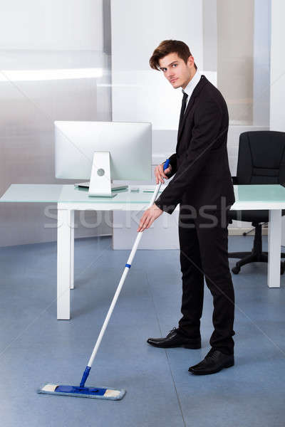Businessman Cleaning Office Stock photo © AndreyPopov
