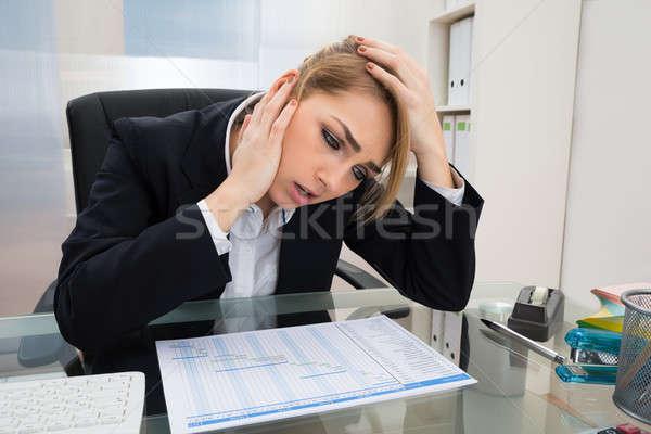 Businesswoman With Gantt Progress Chart At Desk Stock photo © AndreyPopov