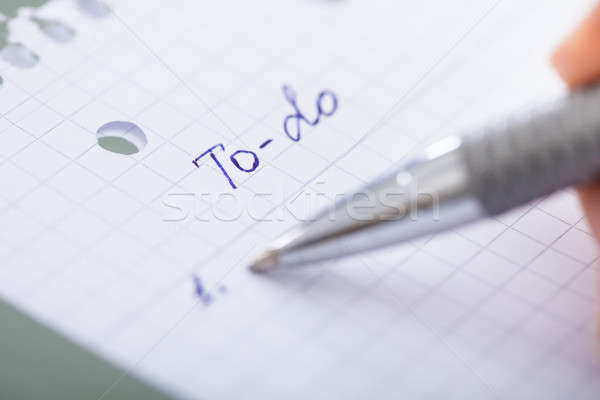 Stock photo: Hand With Pen And Paper