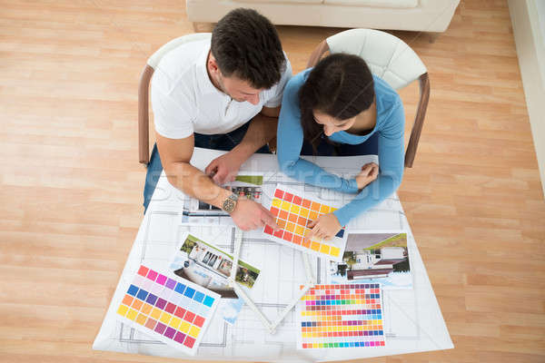 Young Couple Choosing Color From Swatch Stock photo © AndreyPopov