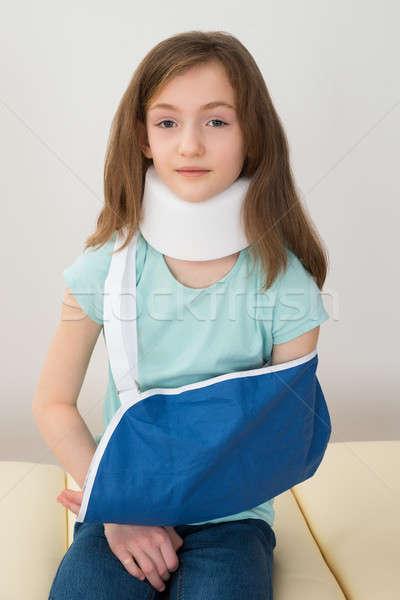 Lány visel nyak kar csúzli portré Stock fotó © AndreyPopov