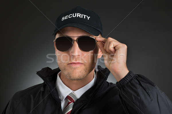 Security Guard Wearing Sun Glasses Stock photo © AndreyPopov