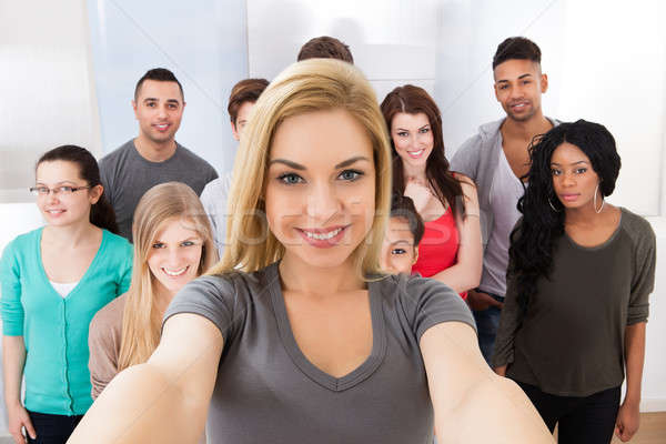 Stock photo: Group Of Friends Taking Selfie