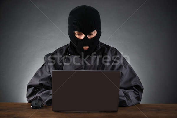 Hacker Stealing Data From A Laptop Stock photo © AndreyPopov