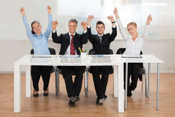 Excitado oficina grupo manos papel Foto stock © AndreyPopov