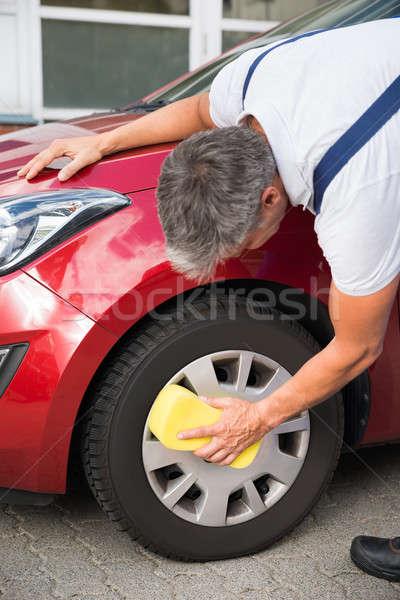 Handyman Cleaning Car Wheel With Sponge Stock photo © AndreyPopov