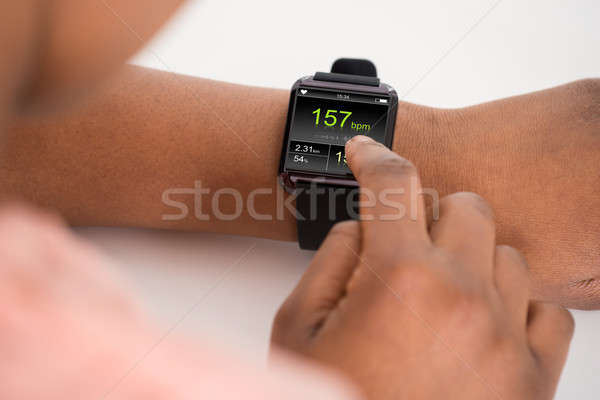 Human Hand Wearing Smartwatch Showing Heartbeat Rate Stock photo © AndreyPopov
