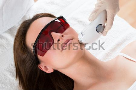 Woman Undergoing Laser Treatment At Salon Stock photo © AndreyPopov