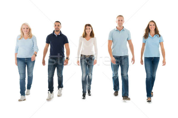 People In Casuals Walking Against White Background Stock photo © AndreyPopov