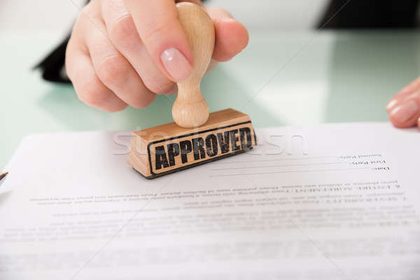 Businesswoman Hand Stamping Approved On Contract Paper Stock photo © AndreyPopov