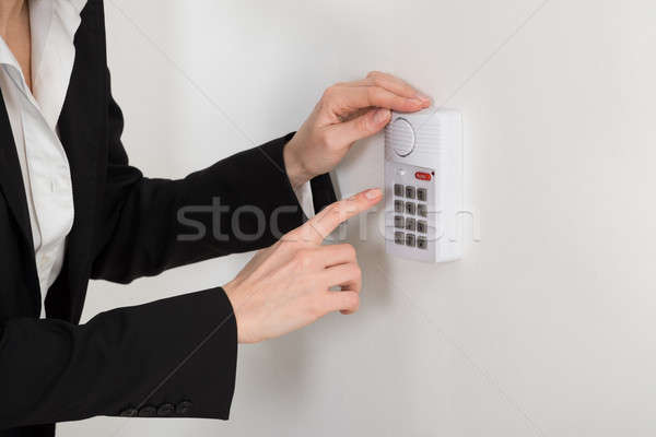 Woman Hand Pressing Button On Security System Stock photo © AndreyPopov