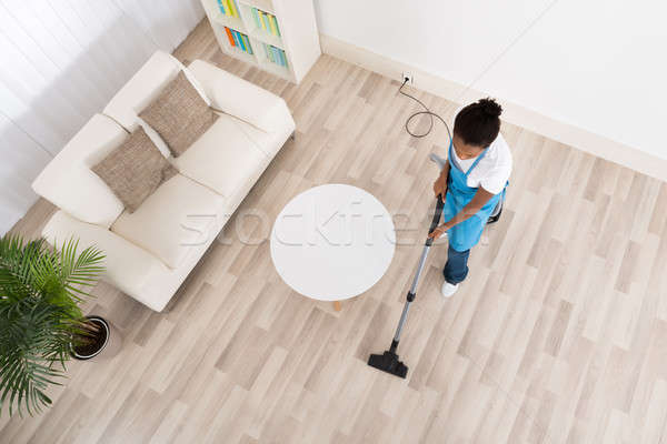 African Female Janitor Cleaning Floor Stock photo © AndreyPopov