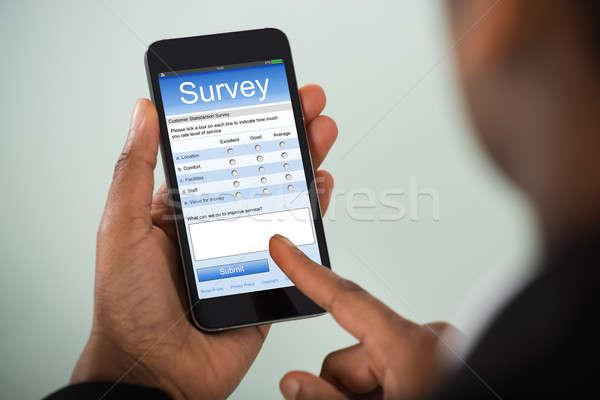 üzletasszony tömés online felmérés mobiltelefon közelkép Stock fotó © AndreyPopov
