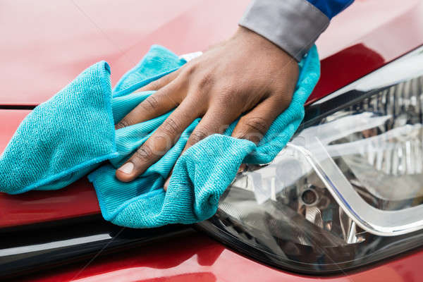 Worker Cleaning Car Headlight Stock photo © AndreyPopov
