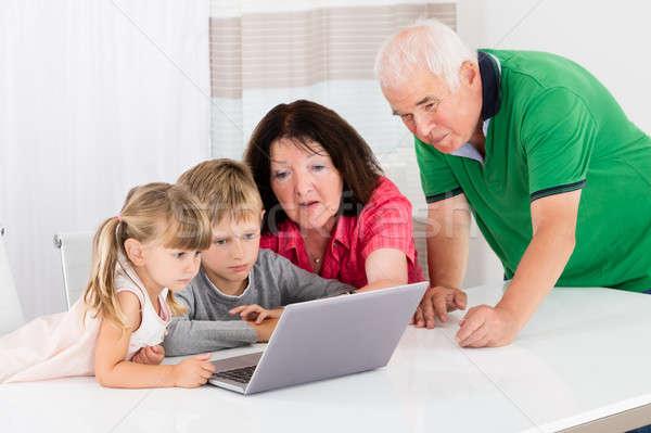 Happy Grandmother With Her Grandchildren Using Laptop Stock photo © AndreyPopov