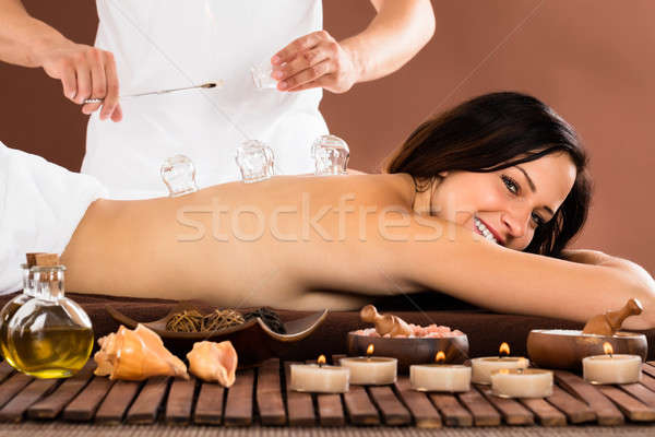 Therapist Giving Cupping Treatment To Woman Stock photo © AndreyPopov
