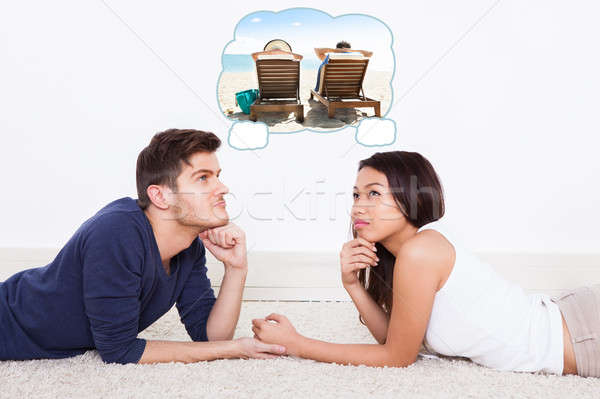 Couple Thinking Of Spending Vacation On Beach Stock photo © AndreyPopov