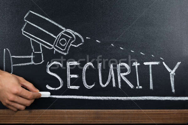 Person Hand Showing Security Concept On Blackboard Stock photo © AndreyPopov