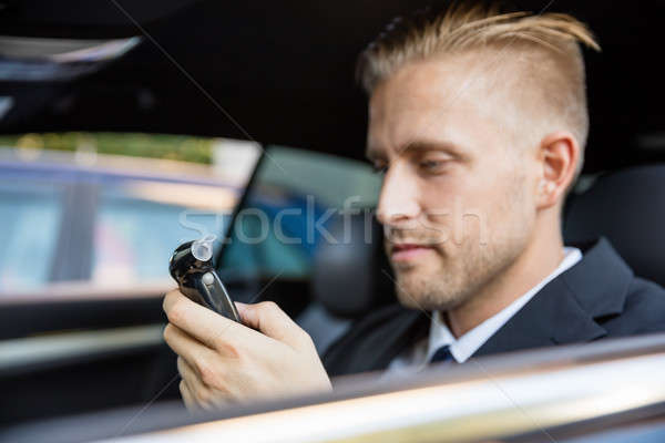 Man Looking At Breathalyzer Test Stock photo © AndreyPopov