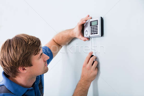 Repairman Fixing Security System Stock photo © AndreyPopov