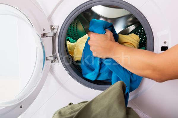 Personne vêtements machine à laver femme main Photo stock © AndreyPopov