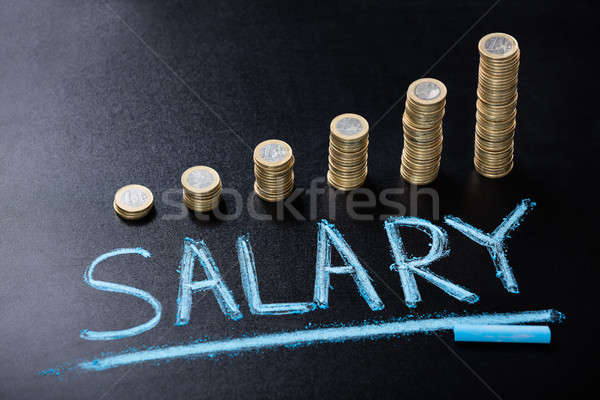 Salary Concept With Stacked Coin On Blackboard Stock photo © AndreyPopov