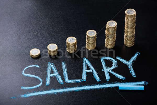 Salario moneda pizarra vista Foto stock © AndreyPopov