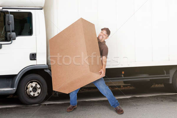 Delivery Man Holding Heavy Box Stock photo © AndreyPopov