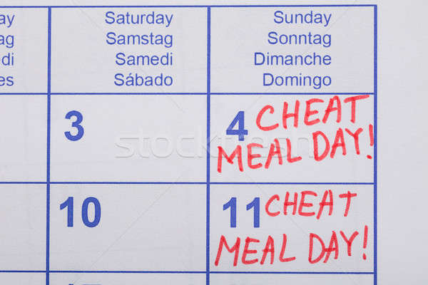 Cheat Meal Day Text Written On Calendar Stock photo © AndreyPopov