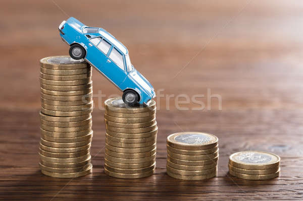 Car Model Over A Stacked Coin Stock photo © AndreyPopov