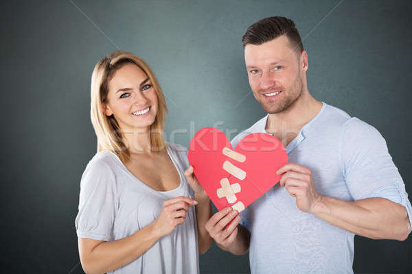 Couple Holding Paper Heart With Bandage Stock photo © AndreyPopov