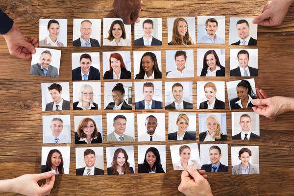 üzletemberek kiválaszt jelölt portré fotó kéz Stock fotó © AndreyPopov