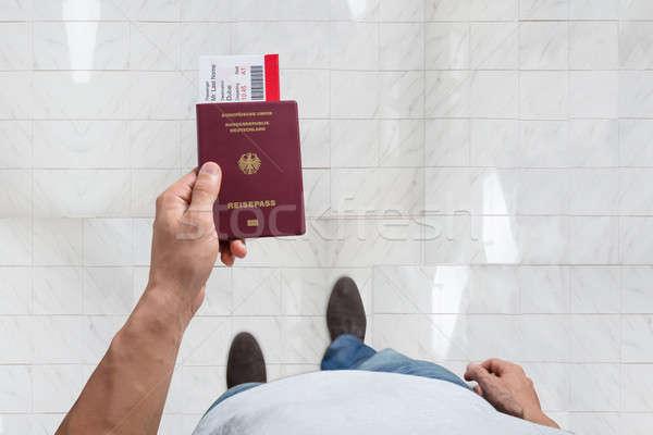Férfi kéz tart útlevél beszállás passz Stock fotó © AndreyPopov