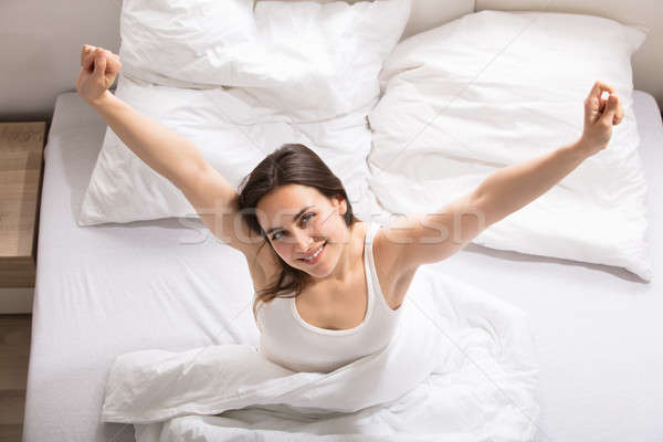 Happy Woman Waking Up Stock photo © AndreyPopov