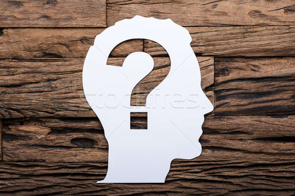 Paper Businessman's Head With Question Mark On Wooden Table Stock photo © AndreyPopov