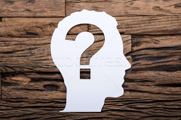 Papír fej kérdőjel fa asztal közvetlenül fölött Stock fotó © AndreyPopov