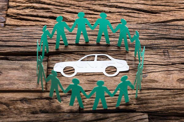 Green Paper Team Surrounding Car On Wooden Table Stock photo © AndreyPopov