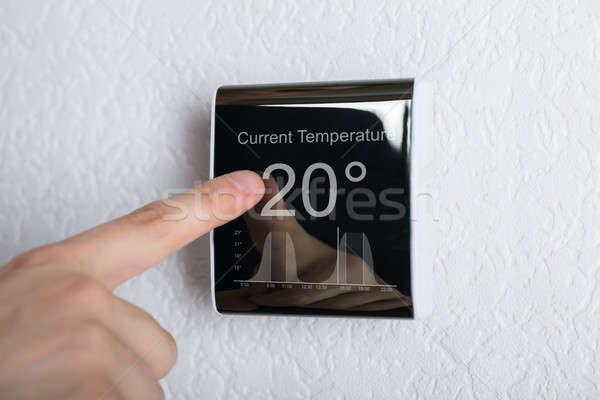 Dokunmak dijital termostat parmak sıcaklık enerji Stok fotoğraf © AndreyPopov