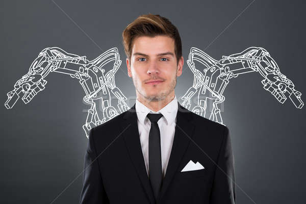 Businessman With Robotic Arms Stock photo © AndreyPopov