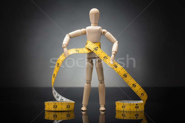 Wooden Dummy Measuring Waist With Measure Tape Stock photo © AndreyPopov