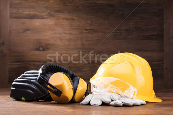 Ear Muff, Safety Glasses, And White Gloves On Table Stock photo © AndreyPopov