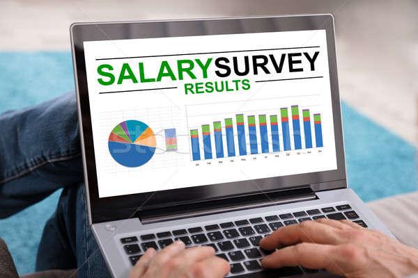 Persona salario estudio resultados portátil primer plano Foto stock © AndreyPopov