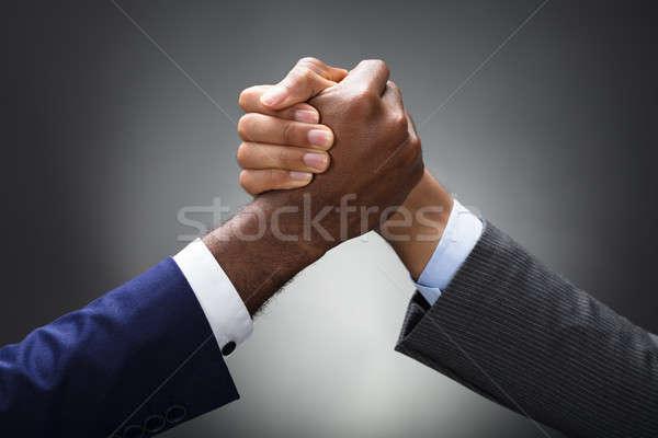 Twee zakenman arm worstelen grijs Stockfoto © AndreyPopov