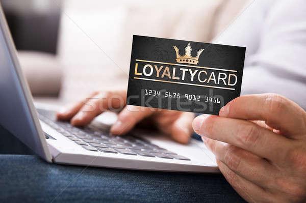 Osoby lojalność karty za pomocą laptopa Zdjęcia stock © AndreyPopov