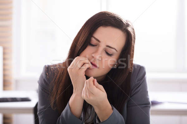 Businesswoman Biting Her Finger Nails Stock photo © AndreyPopov
