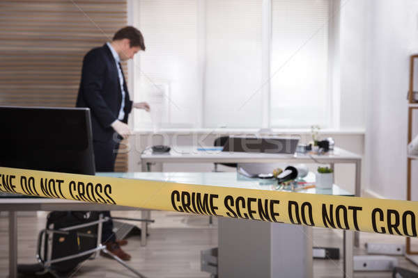 Investigator Collecting Evidence In Office Stock photo © AndreyPopov